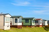 stock photo of trailer park  - Cabins at holiday park in England - JPG