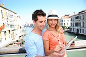 image of academia  - Couple using tablet on the Academia Bridge in Venice - JPG