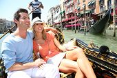 picture of gondola  - Couple in Venice having a Gondola ride on canal grande - JPG