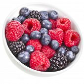 Ripe Fresh Berries in bowl , isolated over a white background
