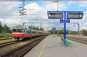 foto of railcar  - Regional train on an empty platform at a railway station - JPG