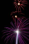 picture of guy fawks  - Purple and red fireworks withe the shape of a heart visible - JPG