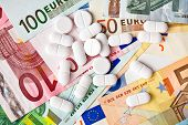 the pills and euro banknotes