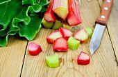 Rhubarb Cut With A Knife On A Board