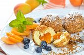 stock photo of apricot  - Sweet apricot dumplings with some blueberries, an Austrian cooked dessert