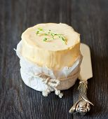image of margarine  - Fresh organic butter and knife on a wooden board.