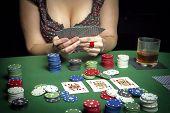 Very Beautiful Woman Playing Texas Hold'em Poker