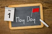 May Day May 1 written on a blackboard