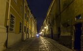 Night Photo Of A Cobbled Street In The Old Part Of Poznan, Poland