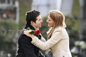foto of fiance  - Romantic couple with rose celebrating anniversary valentines day - JPG