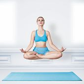 pic of levitation  - Young woman in lotus asana position - JPG
