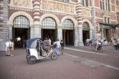 Eco Taxi In Front Of Rijksmuseum In Amsterdam