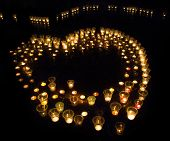 group of several candles as a form of heart