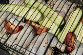 stock photo of marinade  - The marinaded chicken fried on coals on a lattice - JPG