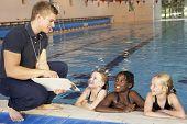Girls having swimming lesson