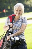 Senior woman on golf course