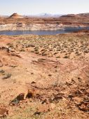 Desert Landscape With River In Background