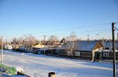 image of paysage  - Winter village in the snow at sunset - JPG