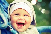 Little Baby Girl Laughs In Pram On The Walk. Instagram Toned Effect