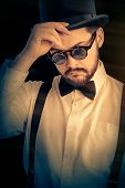 Man with Top Hat and Glasses Retro Portrait