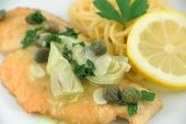 stock photo of artichoke hearts  - Delicious gourmet chicken picatta with noodles - JPG