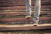 Girl Walking On Stairs. Female Legs On The Road