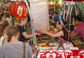 LONDON, UK - June 17, 2014: - Greenwich market, Chinese food counter, traditional Chinese snacks