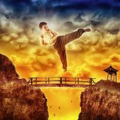 Karate kid jumping over the bridge