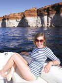 Smiling Young Woman Sitting In Boat
