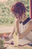 Cute Hipster Girl Drawing Hearts