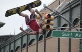 Acrobats perform on Surf Avenue