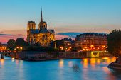 stock photo of notre dame  - The southern facade of Cathedral of Notre Dame de Paris at sunset - JPG
