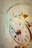 stock photo of pendulum clock  - Table period clock with oscillating mechanism on grunge background - JPG