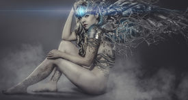 stock photo of gothic girl  - naked woman with iron and metal wings - JPG
