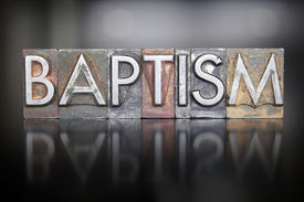 stock photo of baptism  - The word BAPTISM written in vintage letterpress type - JPG