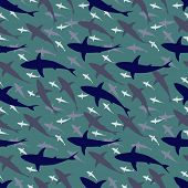Editable vector seamless tile of a large school of sharks swimming