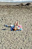 Woman lying on the beach, Marbella.