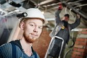line electrician builder engineer worker at indoor construction site