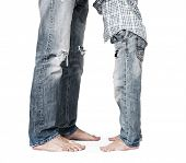 Son And Father Legs In Tattered Jeans