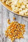 Pile Of Popcorn On Ripe Corn