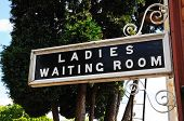 Ladies and Waiting Room sign.