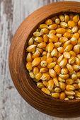 Ripe Corn In Wooden Bowl