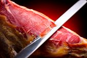 Jamon. Jamon serrano. Traditional Spanish ham on black close up. Slicing Hamon iberico