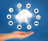 Cloud On Hand Against Blue Sky. Cloud Computing Concept.