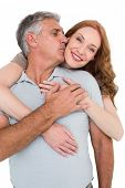 Casual couple hugging and smiling on white background