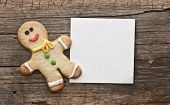 homemade christmas painted ginger-breads (gingerbread man) on the wooden background