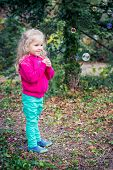 Funny Cute Girl Admires Soap Bubbles