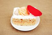 sweet food: cheese cream cake piece on white dish with roses