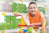 Woman Buying Fruit At Store