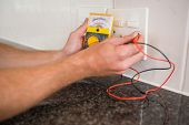 Metering voltage with digital multimeter in the kitchen